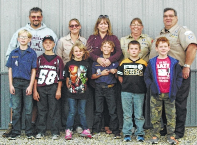 Union Township Trustees Ron Williams, Jim Virts and Chuck Dooley thanked members and leaders of Cub Scout Pack 21 for placing U.S. flags at Fairview and Union Cemetery on Memorial Day and retrieving the flags Sept. 27. Pictured are Pack members Toby Massey, Jacob Bundy, August Bundy, Sam Kidd, Jeremiah Engle and Maggy Lear and leaders Steve Molton, Cynthia Molton, Rob Lear, Kim Lear and Judy Bundy.