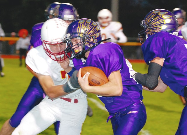 Mechanicsburg's Joey Mascadri battles for extra yardage after a key interception during Friday night's game against visiting Northeastern. Pictured attempting to make the tackle is Northeastern's Casey Hayes.
