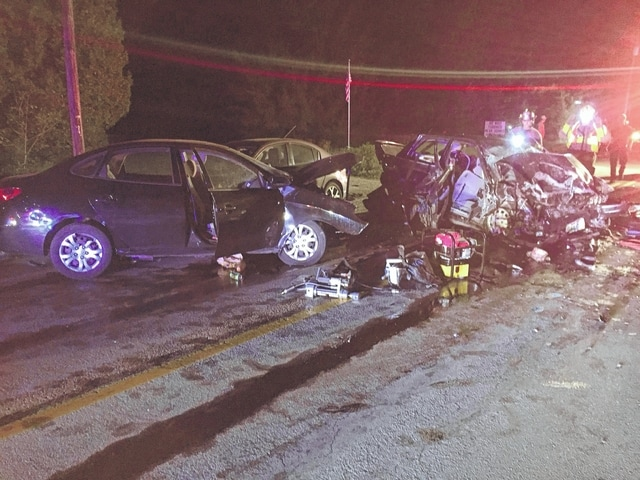Damaged vehicles are pictured after a crash late Saturday evening in the 6000 block of U.S. Route 36.