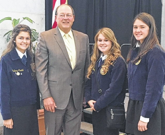 On Sept. 28, three West Liberty-Salem FFA officers attended the Ohio Legislative Leadership Conference and heard speeches, learned processes used by legislators and lobbyists, toured the Ohio State House and spoke with legislators. They also spoke with David Daniels, director of the Ohio Department of Agriculture, and had their photo taken with him. From left are Mallary Caudill, Daniels, Kayleigh Metz and Paige Shafer.