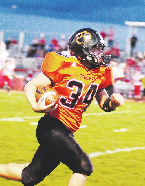 West Liberty-Salem's Chase Humphrey (34) helped lead the Tigers over visiting Triad on Friday.