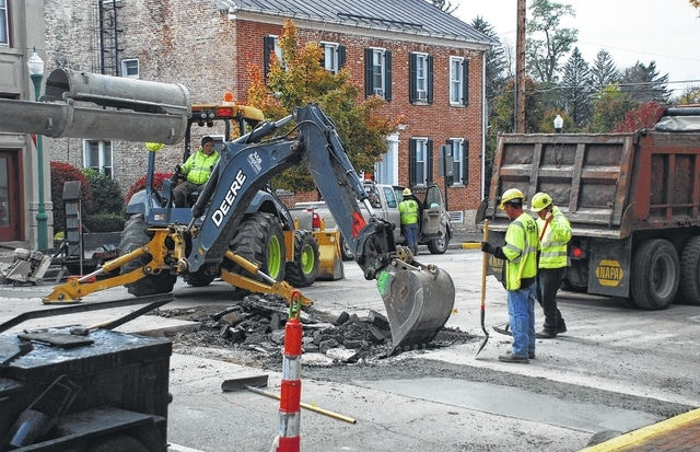 Crews from A&B Asphalt in Springfield repair a section of Miami Street in downtown Urbana on Tuesday as Columbia Gas of Ohio works to complete the restoration phase of its Urbana Natural Gas Line Replacement Project.