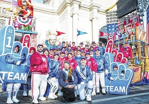 "Pictured are Woodstock native Thomas Nance, float escorts and other float personnel in the 2015 Cracker Jack ""At the Ball Game"" Float for the Macy's Thanksgiving Parade, with celebrity pop singer Andy Grammar. Nance is in the sash at the front."
