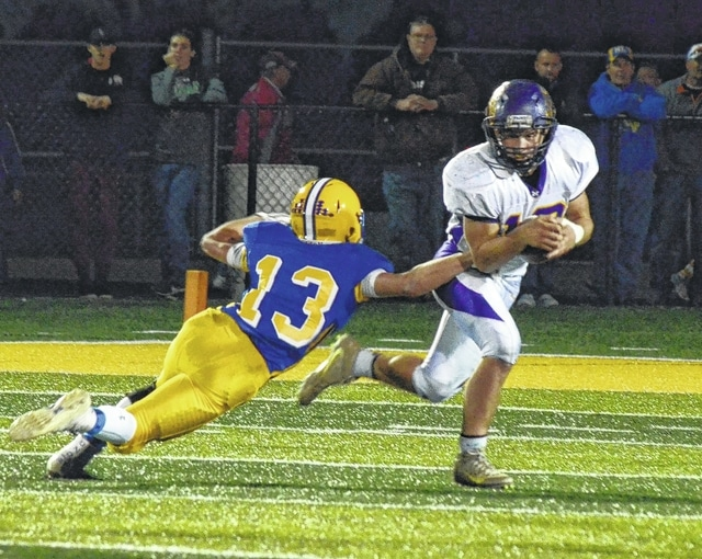 Mechanicsburg's Drew Myers returns a kick against Marion Local on Friday in the Division VI, Region 24 final.