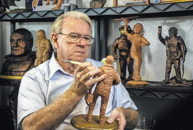 Local artist Don Hatcher works on a clay model inside his Urbana home. After submitting several aviation-related clay models to the Wright Image Group, Hatcher was notified in August that he was selected to sculpt several larger-than-life bronze statues to be placed around the proposed Flight of Triumph monument just north of Dayton.