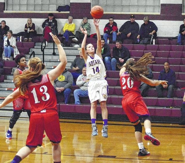 Mechanicsburg's Kasey Schipfer (14) shoots over a Miami Valley defender during the opening round of the Skeeter Classic. Schipfer and fellow freshman Morgan Hamby stepped up to help established players Mikayla Dodane and Elly Schipfer shoulder the scoring load.
