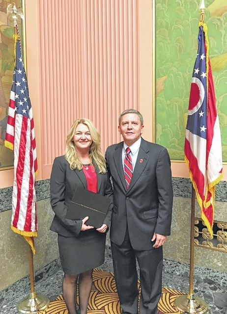 Sandi Perry, left, is pictured with Ohio Supreme Court Administrative Director Michael L. Buenger during the Nov. 18 graduation ceremony.