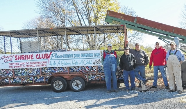 On Nov. 12, several members of the Champaign County Shrine Club helped move the group's main aluminum can collection site from Johnny's Body Shop in Urbana to the county's recycling location behind Vancrest of Urbana, 2380 S. U.S. Route 68. Pictured, left to right, at the new location are club members Dennis Hinkle, Steve King, Greg Burroughs, Kyle Hinkle and Steve Runkle.