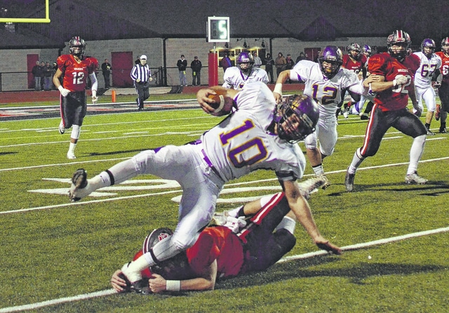 Mechanicsburg quarterback Kaleb Romero (10) is tackled during last week's playoff game with Delphos Jefferson. The Indians play Marion Local today at 7:30 p.m. at Sidney in the Division VI, Region 24 final.