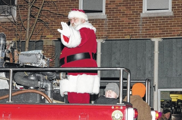 """Santa once again will visit West Liberty during this year's Christmas in the Village, set for Nov. 25-26. Activities include the 18th annual Luminary 5k Run, which starts at 5 p.m. Friday, Nov. 25. The Christmas Parade starts at 6 p.m. Friday, Nov. 25. The theme is """"200 Years of Christmas Past,"""" nodding at the village's 2017 Bicentennial. Participants are encouraged to pick any year in the past 200 years and decorate their floats accordingly. Parade entry forms can be obtained on the village website, mywestliberty.com, and submitted ahead of time or the day of. The parade line-up will be at 5:30 p.m. at Lions Park and the route ends at the firehouse, where Santa will arrive bearing gifts for the kiddos and will sit for pictures in Santa's Workshop."""