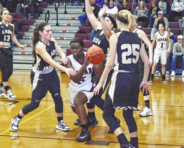 Urbana's Bridget Ofori (5) pulls down an offensive rebound in a sea of Raiders at Urbana High School on Wednesday. Ofori finished with 6 rebounds in the contest.