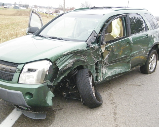 The driver of a 2005 Chevrolet Equinox sustained minor injuries after striking a semi truck on state Route 4 Thursday morning.