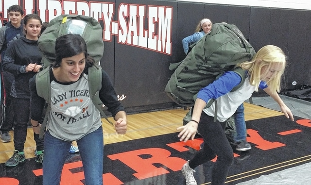 WL-S students Lily Yoder and Laine Godwin prepare to compete in the rucksack race.