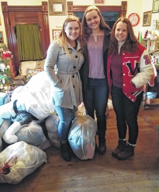 Emma Campbell, Kaylor Pearson and Kara Hollinger drop off stuffed animal donations to Project Teddy Bear & Friends in West Liberty. The donations were the result of a drive effort by Tri Village High School in New Madison and National Honor Society members.