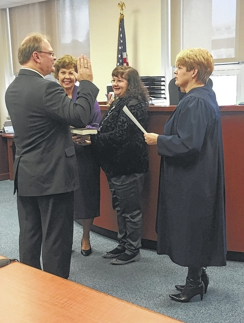 County Engineer Stephen McCall, a Republican, was sworn into office for another term by Judge Lori Reisinger on Thursday. He was unable to attend the Wednesday swearing-in ceremony of other county officials re-elected to office in November. Friends and family attended McCall's ceremony. Also in the photo are his mother, Sharon McCall, and his wife, Jenniffer McCall.