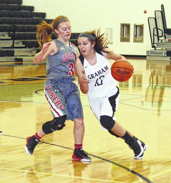 Graham's Katey Nash goes past her defender on Wednesday at Graham High School. The Falcons posted their first win of the season.