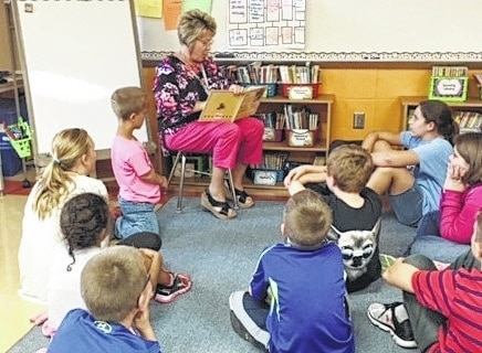 Graham Local Schools Literacy Coach Lori Black reads to third graders in September. Reading proficiency is a main goal for all local school districts, and Graham recently received a grant to help increase access to reading material through the Dolly Parton Imagination Library. Now other agencies want to raise money to offer the same program in Clark, Champaign and Madison counties.