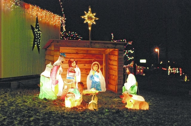 This decked-out home is owned by Barney and Loretta Connolly and is located at 17 Buckhorn Court, just off South U.S. Route 68, south of Urbana. The display features a wide array of lights, Santa, his sleigh and lighted figures. The fence along Route 68 is lined with lights and candy canes. Angels are in the front yard and a nativity scene near the mini-barn. According to his friends, Mr. Connolly is known to dress up as Santa and visit nursing homes and children who have been good all year long.