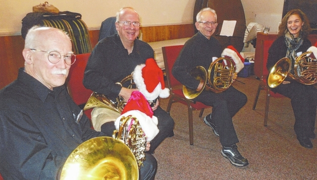"The Champaign County Retired Teachers Association met for a Christmas party and enjoyed a Christmas music program arranged by member Colvin Bear, who heads a French horn quartet named ""The Valley Horns."" From left are Colvin Bear, Mechanicsburg; Steve Vrooman, Springfield; Tom Osborne, Yellow Springs; Krista Caley, Oakwood."