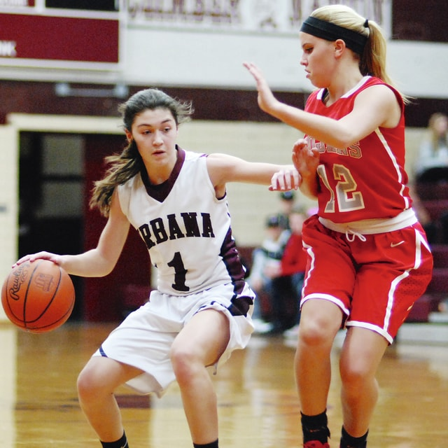 Urbana's Alania Lyons drives against a Southeastern defender during Thursday night's game at UHS.