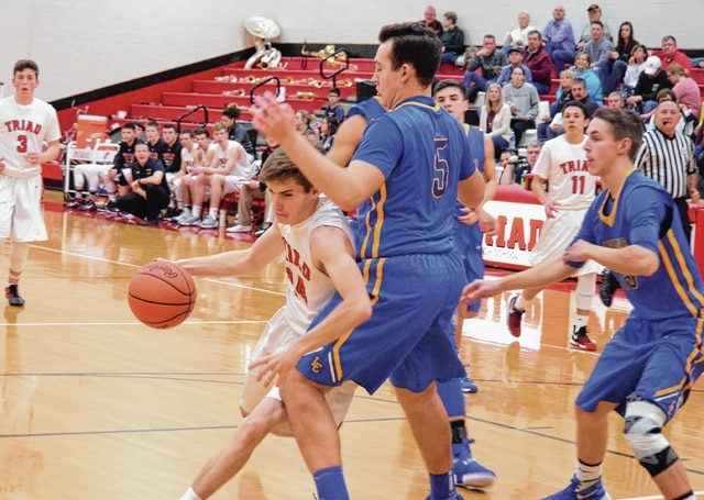 Triad's Alec Ober forces his way into the lane against Lehman Catholic on Tuesday. Ober was aggressive, using his speed to get inside for a handful of buckets.