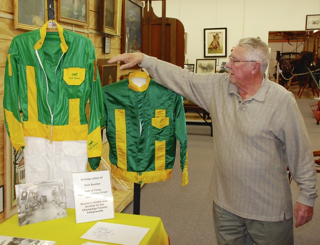 The silks worn by the late harness racing driver Dick Buxton of Urbana are shown as part of a Champaign County Historical Society Museum display. The silks were donated by Buxton's daughter, Mary Beth Henry, in memory of her father. In addition to the silks, there are also photos and other related memorabilia on display. Pictured with the silks is Dick Virts of the historical society. The museum is located on East Lawn Avenue in Urbana. For more information on the museum and its hours, log on to http://www.champaigncountyhistoricalmuseum.org/
