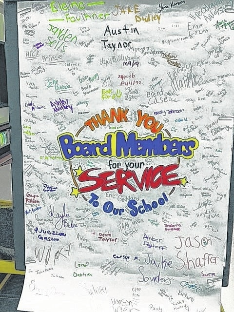 A large poster card signed by Graham Middle School students and staff was presented to board members at the January meeting.