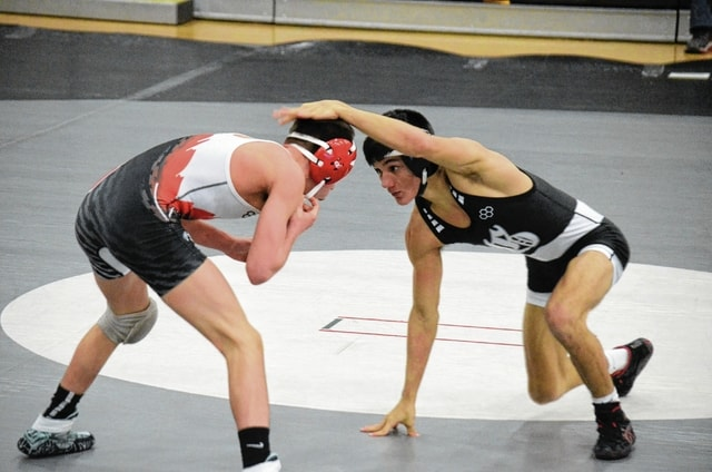 Graham's Dawson Show (right) does battle in the 113-pound weight class against Bellefontaine on Wednesday.