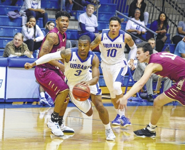 Urbana University's DeQuan Abrom (3) splits the defense off the dribble against Fairmont State on Monday at the Grimes Center.