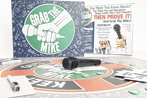 """The """"Grab the Mike"""" karaoke board game was created by St. Paris natives David Konicki and Tracy Carnes."""