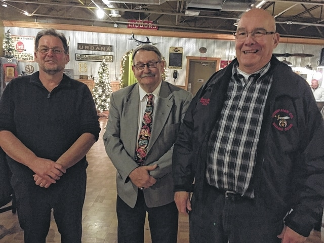 The Champaign County Shrine Club named Noble Dennis Hinkle, right, the 2016 Shriner of the Year. The award was presented by Club President Noble Steve Runkle, left, and Noble Bill Instine, center.