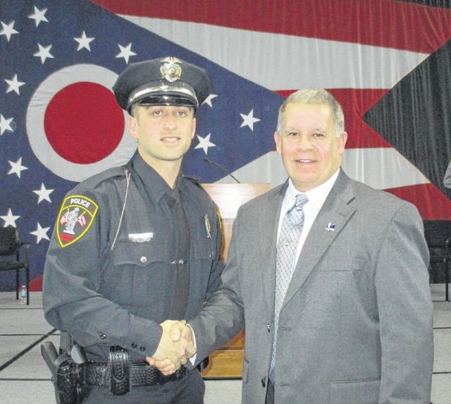 Urbana Police Chief Matt Lingrell (right) congratulates Luke Hiltibran on completing his recent academy training.