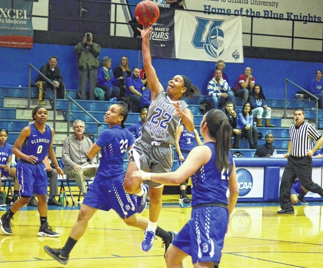 Urbana University's Stefanie Davis (22) soars in for a layup against the Glenville State defense on Thursday at the Grimes Center. Davis scored 18 points in the loss to the Pioneers.