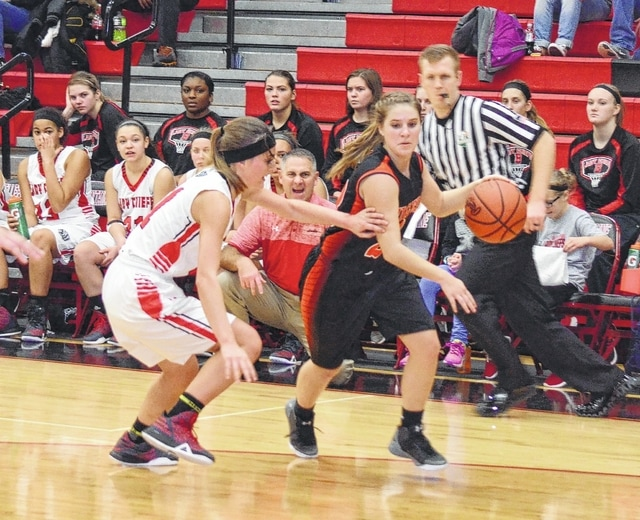 West Liberty-Salem's Taylor Lauck slashes along the baseline on Thursday against Bellefontaine. The Tigers utilized a lot of different options offensively, leading to a 53-39 victory.