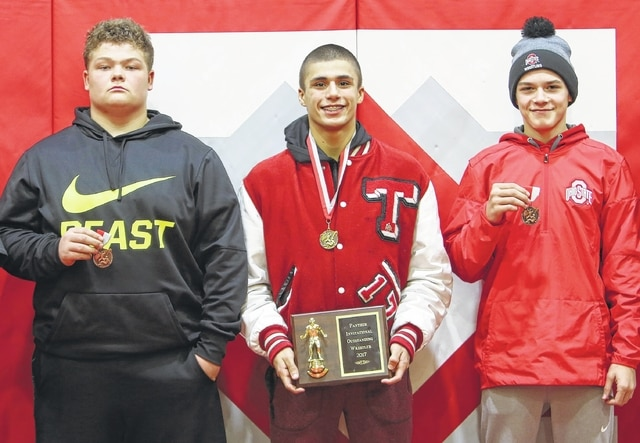Triad finished sixth at the Tri-County North Invitational on Saturday, with only five wrestlers competing. Zackary Zizzo (center) won his class at 145 pounds and was voted the tournament's MVP. Josiah Leasure (285, left) and Dalton Overfield (126) each finished third.