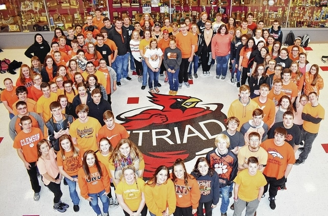 Triad Local Schools students show solidarity with West Liberty-Salem Local Schools by displaying their orange and black Monday. The district also wore the WL-S colors Friday during Triad's basketball game.