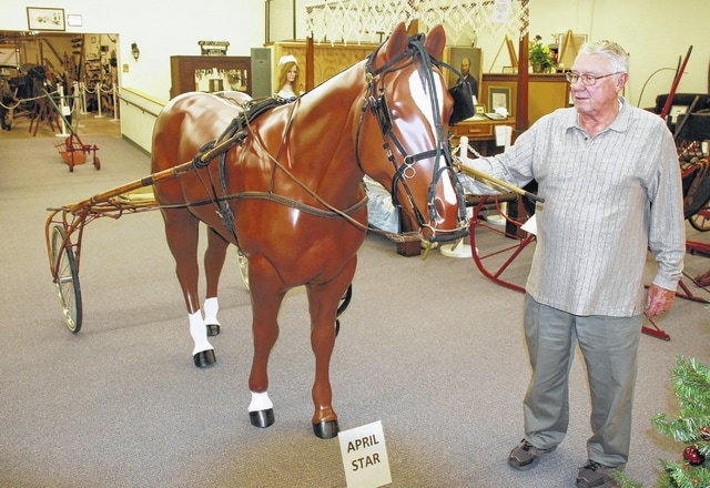 """Residents of St. Paris will recognize this horse, which used to be part of an outdoor display at a western wear shop in the village. It has since been acquired by the Champaign County Historical Society Museum, and local resident Dave Bacher volunteered to paint it as a salute to the famous local harness racing horse """"April Star"""" - which is buried in the infield at the track at the Champaign County Fairgrounds. Pictured with the horse is Dick Virts of the historical society. The museum is located on East Lawn Avenue in Urbana. For more information on the museum and its hours, log on to http://www.champaigncountyhistoricalmuseum.org/"""