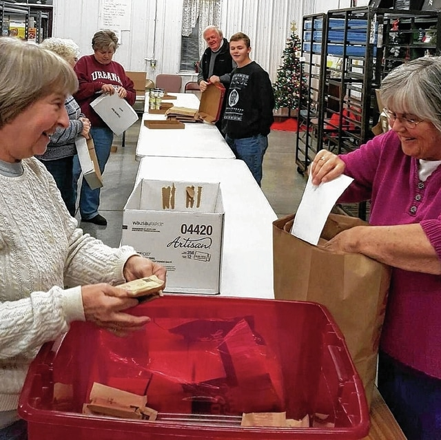 Volunteers at the WhereHouse food ministry prepare for food distribution to local families.