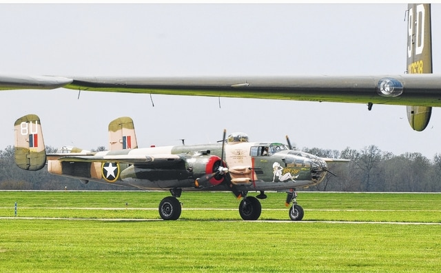 "In this <em>Daily Citizen</em> file photo, a B-25 Mitchell bomber makes its way down a taxi lane at Grimes Field during a gathering of WWII aircraft in 2010. Known as ""Yellow Rose,"" the B-25 is operated by the Commemorative Air Force Central Texas Wing."