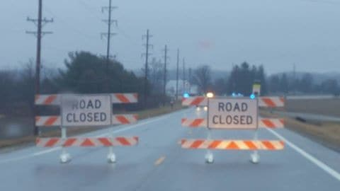 "Motorists encountered these ""Road Closed"" signs during the rainy commute on U.S. Route 68 Friday morning after a student was shot on campus at West Liberty-Salem schools."