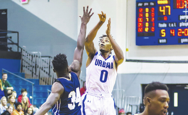 UU's Charles Sweatt-Washington (0) shoots over a Shepherd defender during Saturday's game at UU.