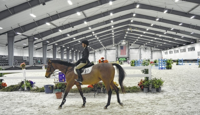 On New Year's Eve, 15-year-old Hannah Trebour of Charlottesville, Virginia rides Pinckney Hill in the Sanctuary Arena's warm-up area at World Equestrian Center. The trainer, Michelle Mahoney with the Rabbit Run barn of Charlottesville, said it was their first time at the center and they were really enjoying it. She said it's nice to have someplace in addition to Florida to go for winter equestrian shows.
