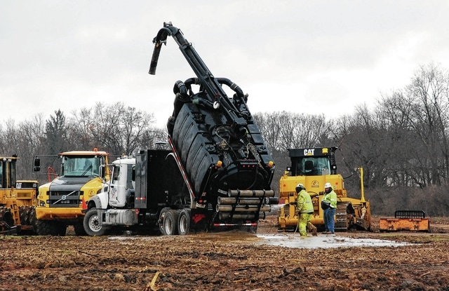 A crew working on the site of a warehouse being built on Phoenix Drive in Urbana cleans off equipment on a Porta Kleen hydro excavation truck on Tuesday afternoon.
