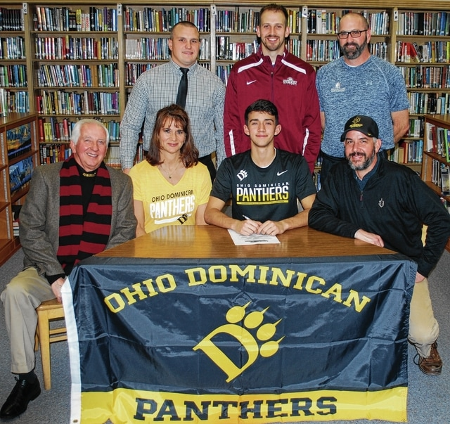 All State soccer player Cooper Johnson, Urbana, signs to play football (kick and punt) at Ohio Dominican. Shown in the photo are, seated from left, Than Johnson (grandfather), Amy Johnson (mom), Cooper, Lance Johnson (dad), standing from left, former head football coach Jon Daniels, Special Teams Coach Patrick Trenor and Trainer Ed Wisner.