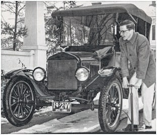 "The Champaign County Historical Society will host Robert McConnell at 2 p.m. Sunday, Feb. 19, at the museum, 809 East Lawn Ave. An Urbana native and businessman, McConnell purchased a Model T Ford for $25 at the age of 13. He had no idea that his ""hobby"" would burgeon into a business that now provides 1909-1948 Ford parts to enthusiasts both here and abroad. The public is invited to hear McConnell relate how he grew the business, Gaslight Auto Parts, and used other Champaign County businesses along the way. This photo shows McConnell putting air into a Model T. The tag seems to read: 1922 VV dated 1955 OHIO"