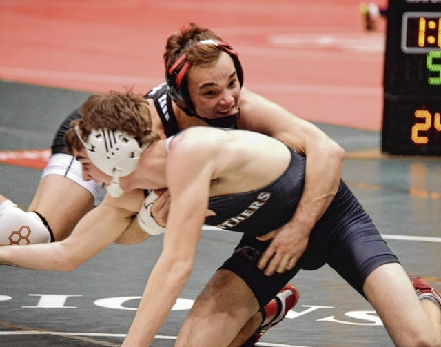 Graham's Mitch Moore (132) spins his way around Miami Trace's Coby Hughes on Sunday at the state team duals at St. John Arena. Moore, injured for much of the season, returned to form with a 16-1 technical fall victory.
