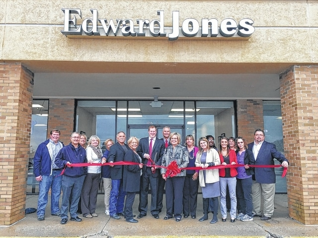 The Champaign County Chamber hosted a ribbon-cutting Jan. 20 for the opening of the Edward Jones office of Zac Fiely in Suite 6 at 1637 E. U.S. 36, Urbana. From left are Kyle Hall, Jerome Armstrong, Lora Brown, Tami Purinton, Sunny Krugh, Larry Krugh, Chamber Director Sandi Arnold, Edward Jones agent Zac Fiely, Dennis Serie, Office Administrator Karen Adams, Shawn Holland, Megan Gerlach, Tiffany Couts, Gabby Mulkey, Tammy Hux, Katherine Loeloff, and Rodney Krugh.