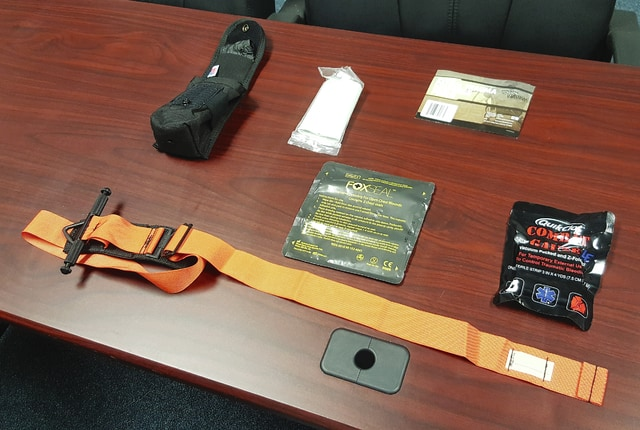 Pictured are items included in self-medication kits Champaign County Sheriff Deputies will carry on their belt, including a tourniquet, gauzes, bandages and other items. The sheriff's office is implementing these items after consulting with the Urbana Fire Division on finding self-aid medical kits.