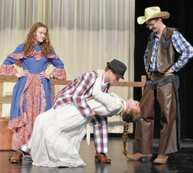 """From left, Abbey Kramer as Gertie Cummins, Joey Mascadri as Ali Hakim, Emma Wilson as Ado Annie, and Alex Miller as Will Parker rehearse a scene from """"Oklahoma!"""" which Mechanicsburg High School students will stage at 7:30 p.m. March 17 and 18, and at 2:30 p.m. March 19 at the High School Commons. All seats are reserved. Ticket forms are available in the superintendent's office and by calling 937-834-2453, ext. 2137 and by emailing marsha@mcburg.org. Tickets are $10 for adults and $7 for students and senior citizens."""