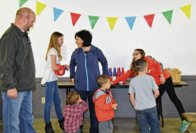 The Kids Zone had numerous activities for young and older, including a ring-toss game.